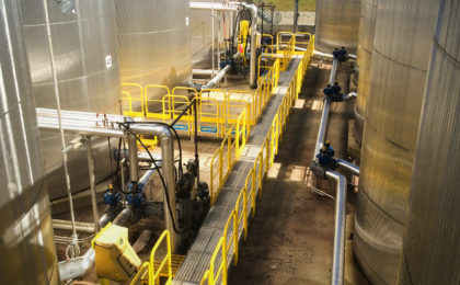 Erectastep industrial crossover stairs and access platform between tanks
