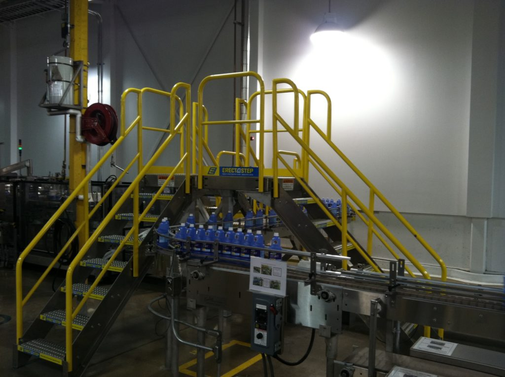Erectastep industrial crossover stairs on manufacturing line