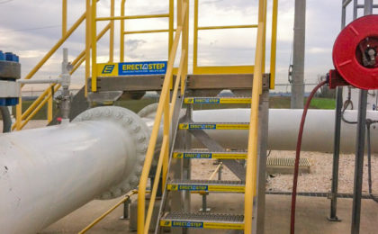 Erectastep multidirectional industrial crossover stairs across large pipe