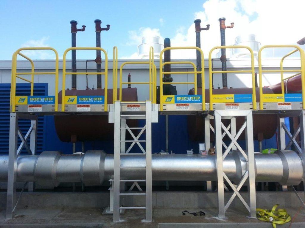 Erectastep ladder access platform over industrial pipe